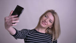 Closeup portrait of adult attractive blonde caucasian female taking selfies on Footage