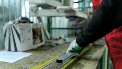 Manual worker assembling PVC doors and windows. Workers in workshop Footage