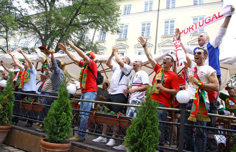 Portugal football team supporters walk on a streets of Lviv Photo