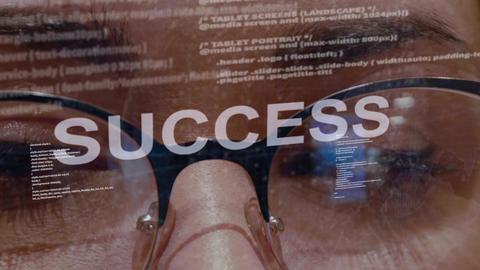 Success text on female software developer Live Action