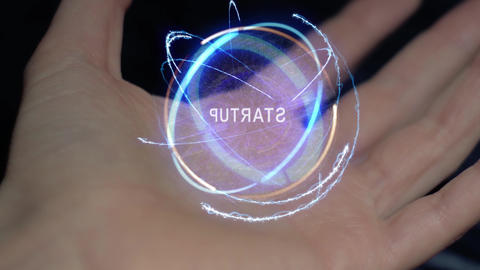 Startup text hologram on a female hand Footage