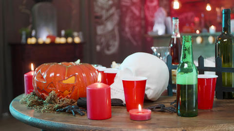 Jack-o-lantern, skull and other halloween decorations before an big party Footage
