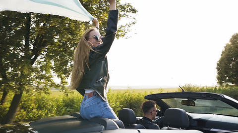 Beautiful young man and woman during trip in the cabriolet on the nature Footage