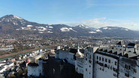 Aerial footage of the Hohensalzburg castle with the mountains on the background Live Action