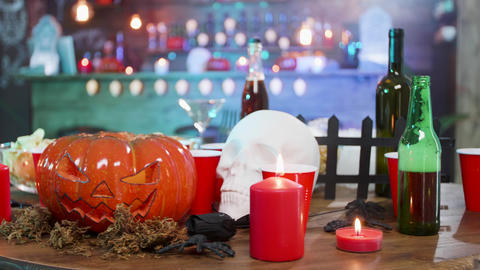 Halloween still life decoration on a table in a pub ready for a party Live Action
