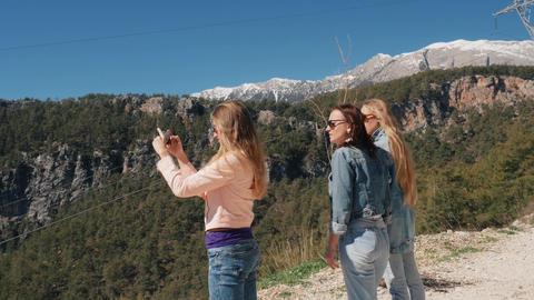 Young girls at viewpoint to take pictures Live Action