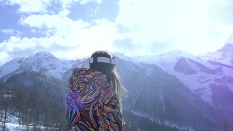 Beautiful young girl wearing ski goggles. Smiles and gets... Stock Video Footage
