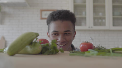 Fresh vegetable zucchini, tomatoes and greens laying on the table. The positive Footage