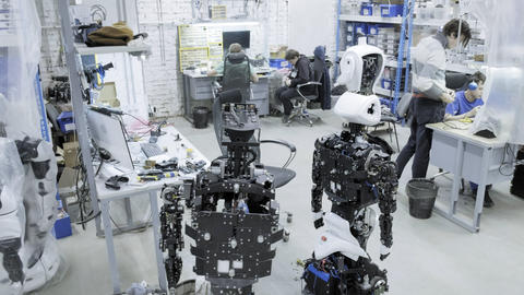 Factory for the production of robots, modern robotic developments. A group of Live Action
