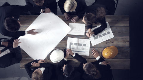 Business People Looking At Building Blueprint stock footage