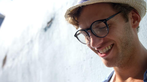 Close up of hipster is looking something and smiling Live Action