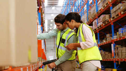 Warehouse workers working together Footage