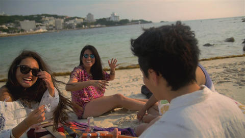 Attractive fun group of people party on the beach international friends Japanese Live Action