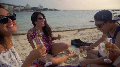 Fun group of friends playing drinking champaign together on the beach side perfe Footage