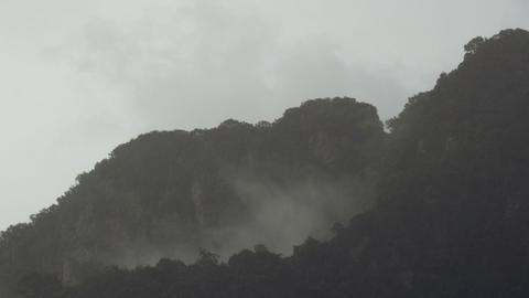 Timelapse of Mist and Rain Over Tropical Mountains Stock Video Footage