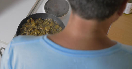 Man cooking stewed vegetables at home Footage