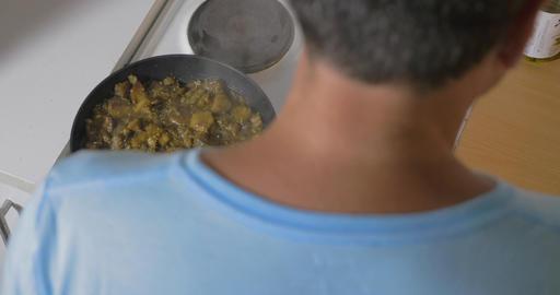 Man cooking stewed vegetables at home Footage