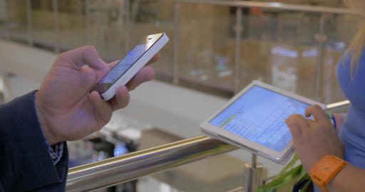 People using smart phone and pad in trade centre Footage