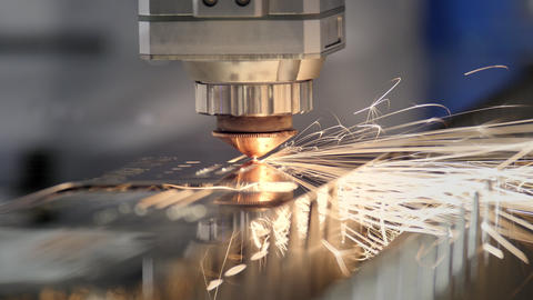 Cutting of metal. Sparks fly from laser. Industrial laser cutter with sparks Footage