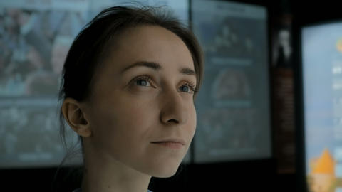 Young woman looking around in modern historical museum Footage