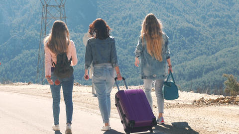 Three young girls walking down the road with beautiful nature landscape Live Action