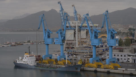 Container port with moored cargo ship in coastal city Archivo