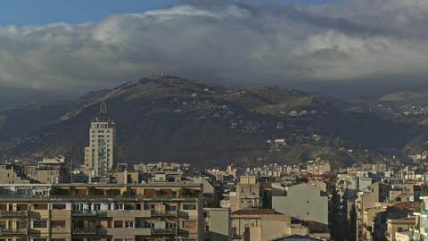Timelapse of clouds over Palermo, Italy. City scene with green hills Footage