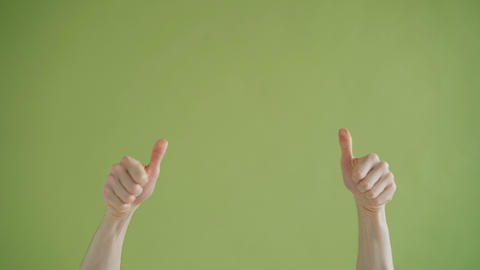 Close-up of human hands pointing at copyspace in between showing thumbs-up ライブ動画