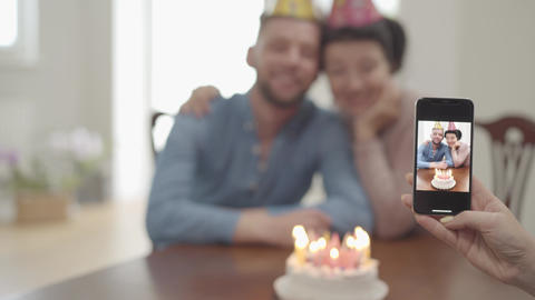 The female hand making a photo on the cellphone of happy smiling mature woman Footage