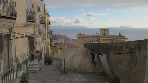 Empty street with old shabby houses and paved path in Naples, Italy Archivo