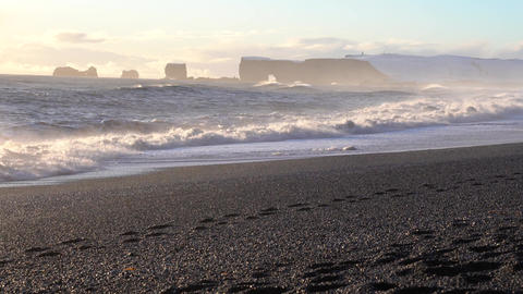 Cape Dyrholaey on a winter day with snow-covered coastline, Iceland Footage