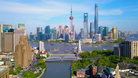 Aerial view of skyscraper and high-rise office buildings in Shanghai Downtown with Huangpu River, Live Action