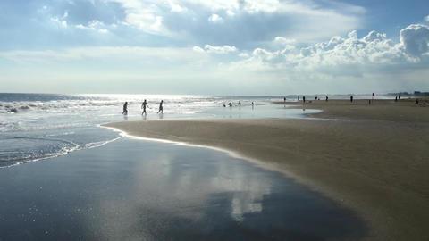 Beautiful Kuta beach with reflection in sea in Bali, Indonesia, 4k footage video Footage