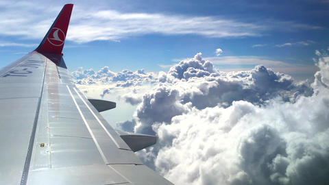 Europe, 20 MAR 2019 - The wing of Turkish Airlines plane in the beautiful clouds Footage