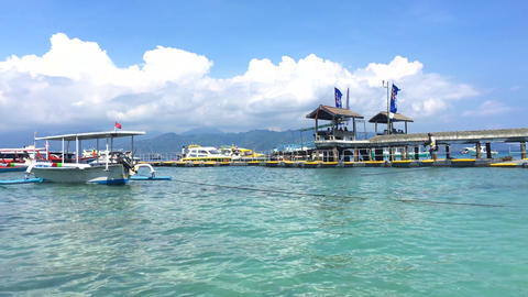 Beach by a public harbour or port on Gili Trawangan, the party island, in Footage
