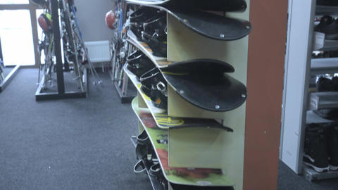 Rack with snowboards. Ski equipment rental at the resort Footage