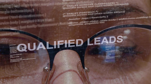 Qualified leads text on female software developer Live Action