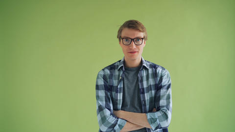 Portrait of playful young man hipster making funny faces…, Live Action