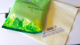 Japanese snack food on airplane ANA flight to Tokyo with rice crackers Footage