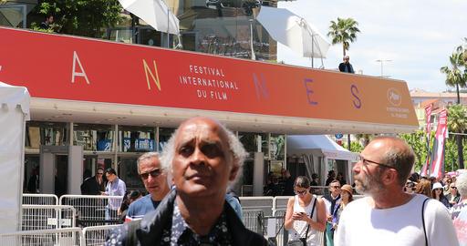People Walking in Front of Palais des Festivals et des Congres Building in Cannes Footage
