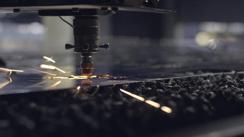 CNC Laser cutting of flat sheet metal steel material on a lathe with the program Live Action