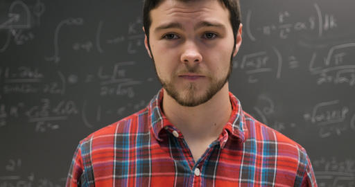 Nervous anxious young man twitching and having a minor panic attack in front of a complex math Live Action