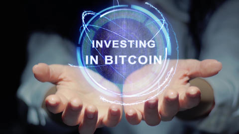Hands show round hologram Investing in Bitcoin Footage