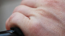 Skin of Hands and Fingers Holding an Object Footage