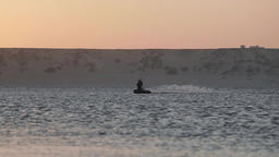 Silhouette of Person Kiteboarding at Sundown Footage