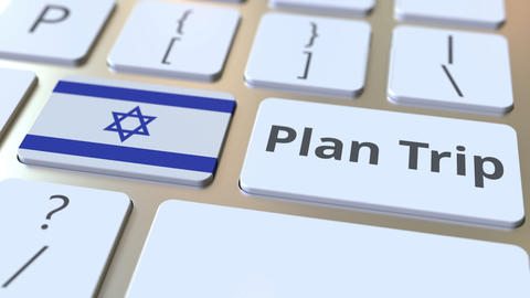 PLAN TRIP text and flag of Israel on the computer keyboard, travel related 3D Footage