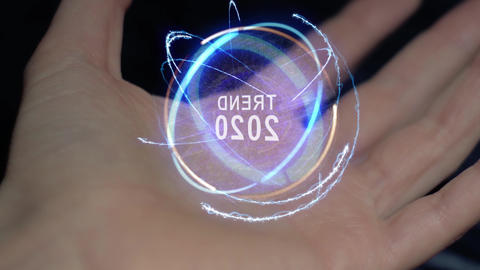 Trend 2020 text hologram on a female hand Footage