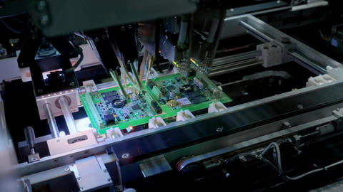 Factory Machine at Work: Printed Circuit Board Being... Stock Video Footage