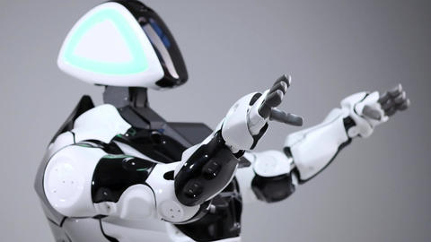 Modern Robotic Technologies. White modern robot in a bright studio. Android Footage