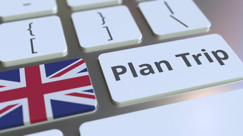 PLAN TRIP text and flag of Great Britain on the computer keyboard, travel Footage